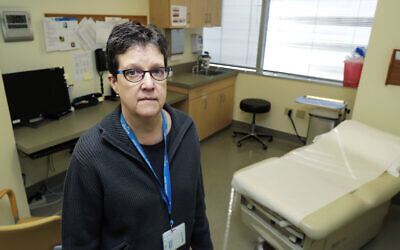 Dr. Lisa Jackson, a senior investigator at the Kaiser Permanente Washington Health Research Institute, poses for a photo, Sunday, March 15, 2020, in Seattle. (AP Photo/Ted S. Warren)