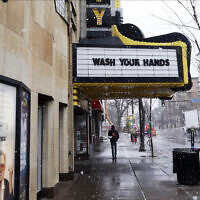 The Varsity Theater, home to concerts, used the marquee to address the need for washing hands due to the coronavirus, the disease that is caused by the new coronavirus, March 16, 2020 near the University of Minnesota in Minneapolis. (AP Photo/Jim Mone)
