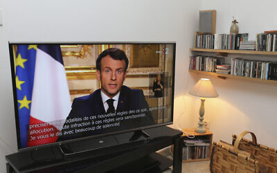 French President Emmanuel Macron speaks during a television address, in Ciboure, southwestern France, March 16, 2020. (Bob Edme/AP)
