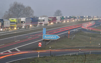 Trucks are jammed in the early morning on Autobahn 12 in front of the German-Polish border crossing near Frankfurt (Oder), Germany, March 18, 2020. (Patrick Pleul/dpa via AP)