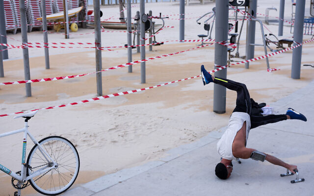 This March 19, 2020 photo shows a free gym at Tel Aviv's beachfront wrapped in tape to prevent public access. (AP Photo/Oded Balilty)