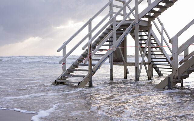 This March 19, 2020 photo shows the stairway to a lifeguard tower at Tel Aviv's beachfront wrapped in tape to prevent public access. (AP Photo/Oded Balilty)