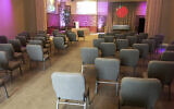 This March 19, 2020 photo provided by Bob Arrington of Arrington Funeral Directors shows a viewing room with seating arranged to facilitate social distancing amid the coronavirus outbreak, at their funeral home in Jackson, Tennessee. (Cliff Walker Jr./Arrington Funeral Directors via AP)