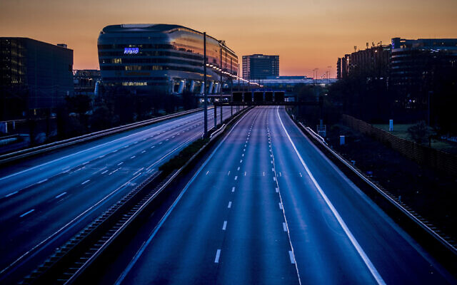 The highway along the airport is empty in Frankfurt, Germany, Sunday, March 22, 2020. (AP Photo/Michael Probst)