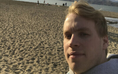 """Lance Sell takes a selfie on a San Francisco beach while walking, March 20, 2020. Sell, 19, is a freshman at Lehigh University and says a lot of people his age are """"spooked""""  by the coronavirus crisis. (Lance Sell via AP)"""
