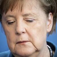 German Chancellor Angela Merkel speaks at a press conference about coronavirus, in Berlin, March 22, 2020. (Michael Kappeler/ Pool photo via AP)