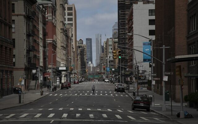 A cyclist rides his bicycle down the middle of a main road in downtown New York, March 22, 2020. (Wong Maye-E/AP)