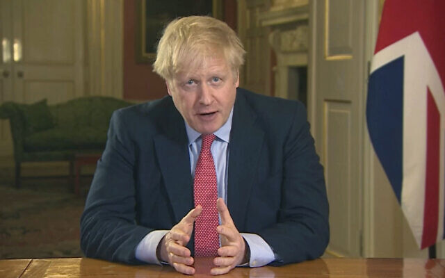 In this screen grab taken from video, Britain's Prime Minister Boris Johnson addresses the nation from 10 Downing Street, in London, Monday March 23, 2020. Johnson has ordered the closure of most retail stores and banned gatherings for three in a stepped-up response to slow the new coronavirus.  (UK Pool via AP)