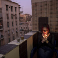 Egyptian transgender woman and activist Malak el-Kashif smokes a cigarette in the balcony of her apartment in Cairo, Egypt, October 28, 2019. (AP Photo/Nariman El-Mofty)