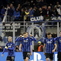 In this  file photo, Atalanta's Josip Ilicic, second left, celebrates with teammates after scoring his side's second goal during the Champions League round of 16, first leg, soccer match between Atalanta and Valencia at the San Siro stadium in Milan, Italy, February 19, 2020. (AP Photo/Luca Bruno, File)