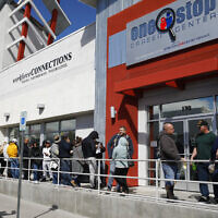 People wait in line for help with unemployment benefits at the One-Stop Career Center in Las Vegas, March 17, 2020. (AP Photo/John Locher, File)