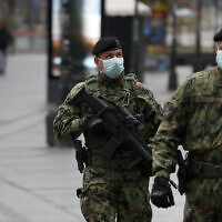 Serbian army soldiers patrol in Belgrade's main pedestrian street, in Serbia, March 26, 2020. (Darko Vojinovic/AP)