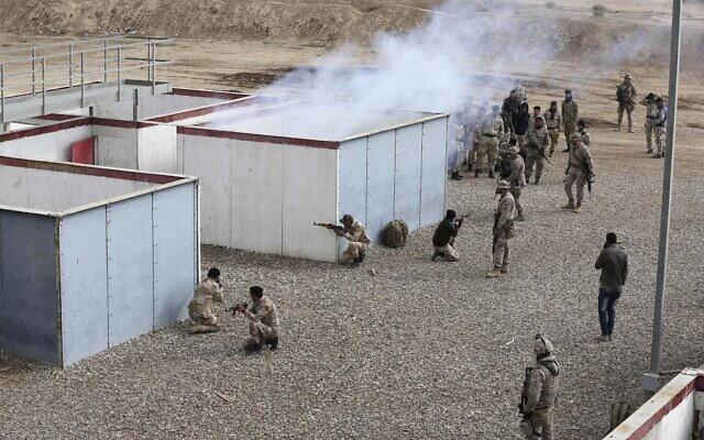 Illustrative: Nineveh police forces train with Spanish coalition members at Basmaya base southeast of Baghdad, Iraq, February 1, 2017. (Karim Kadim/AP)
