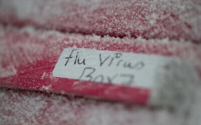 A frozen box of flu virus strains is seen at the Vaccine Research Center at the National Institutes of Health, on Tuesday, Dec. 19, 2017, in Bethesda, Md. 2018 was the 100th anniversary of the Spanish Flu pandemic. (AP Photo/Carolyn Kaster)