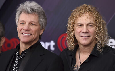 Jon Bon Jovi, left, and David Bryan, of Bon Jovi, arrive at the iHeartRadio Music Awards at The Forum on March 11, 2018, in Inglewood, California. (Jordan Strauss/Invision/AP)