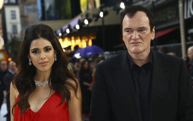 Writer and director Quentin Tarantino and his wife Daniella Pick pose for photographers upon arrival at the UK premiere for Once Upon A Time in Hollywood, at a central London cinema, July 30, 2019. (Photo by Joel C Ryan/Invision/AP)