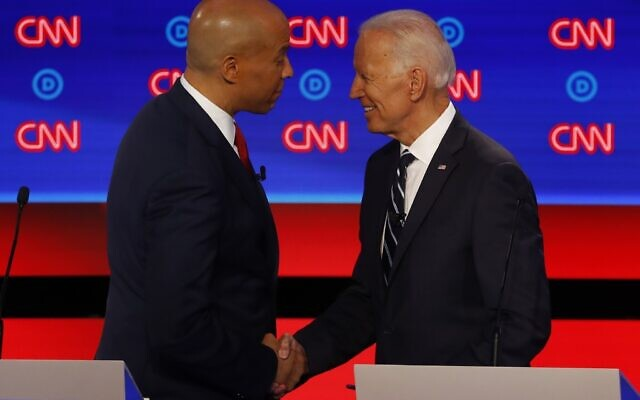 Sen. Cory Booker shakes hands with former Vice President Joe Biden after the second of two Democratic presidential primary debates, July 31, 2019, in the Fox Theatre in Detroit. (AP Photo/Paul Sancya)