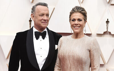 Tom Hanks, left, and Rita Wilson arrive at the Oscars on February 9, 2020, at the Dolby Theatre in Los Angeles. (Photo by Jordan Strauss/Invision/AP)