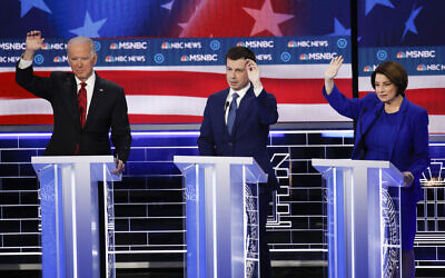 Former US vice president Joe Biden, from left, former South Bend Mayor Pete Buttigieg, Minnesota Senator Amy Klobuchar gesture during a Democratic presidential primary debate on February 19, 2020, in Las Vegas, hosted by NBC News and MSNBC. (AP Photo/John Locher)