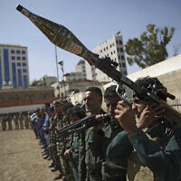 Houthi rebel fighters display their weapons during a gathering aimed at mobilizing more fighters for the Iranian-backed Houthi movement, in Sanaa, Yemen, Thursday, Feb. 20, 2020.  (AP/Hani Mohammed)