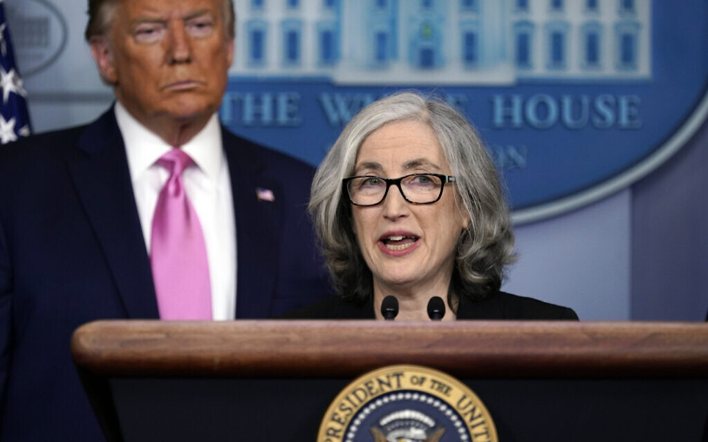 US President Donald Trump listens as Anne Schuchat, principal deputy director of the Centers for Disease Control and Prevention, speaks during a news conference about the coronavirus in the Brady Press Briefing Room of the White House, February 26, 2020, in Washington. (AP Photo/Evan Vucci)