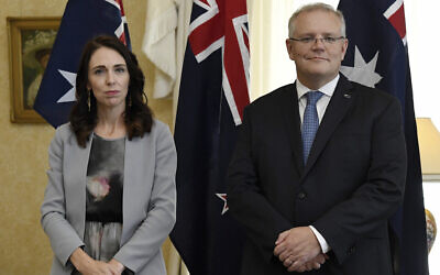 Illustrative: New Zealand Prime Minister Jacinda Ardern, left, stands with Australian Prime Minister Scott Morrison during the signing of the Indigenous Collaboration Arrangement at Admiralty House in Sydney, February 28, 2020. (Bianca De Marchi/Pool Photo via AP)