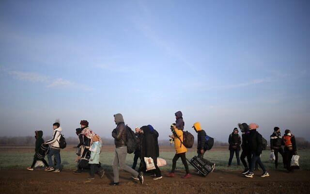 Migrants walk to reach Pazarakule border gate, Edirne, Turkey, at the Turkish-Greek border, March 1, 2020. (Emre Tazegul/AP)