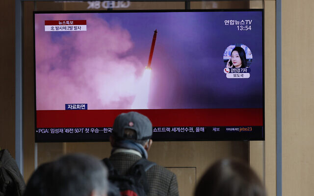 People watch a TV screen showing a news program reporting about North Korea's firing of projectiles with a file image at the Seoul Railway Station in Seoul, South Korea, March 2, 2020  (AP Photo/Lee Jin-man)
