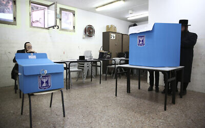 Ultra-orthodox man votes during elections in Bnei Brak, Israel, March 2, 2020. (AP Photo/Oded Balilty)