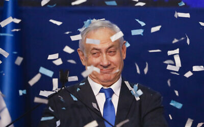 Israeli Prime Minister Benjamin Netanyahu smiles after first exit poll results for the Israeli elections at his party's headquarters in Tel Aviv,  March 3, 2020. (AP/Ariel Schalit)