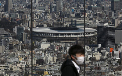 The New National Stadium, a venue for the opening and closing ceremonies at the Tokyo 2020 Olympics, is seen from Shibuya Sky observation deck in Tokyo, March 3, 2020 (AP Photo/Jae C. Hong)