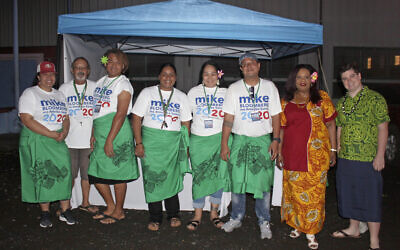 Supporters along with two US based officials for the Mike Bloomberg campaign gather on March 3, 2020, in Tafuna village near Pago Pago, American Samoa (AP Photo/Fili Sagapolutele)