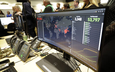 A monitor displays world-wide statistics relating to the spread of the COVID-19 coronavirus during a visit of Vice President Mike Pence to the Washington State Emergency Operations Center, Thursday, March 5, 2020 at Camp Murray in Washington state. (AP/Ted S. Warren)