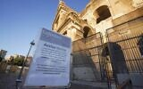 A sign advises that Colosseum will be closed, following the government's new prevention measures on public gatherings, in Rome, March 8, 2020. (Andrew Medichini/AP)