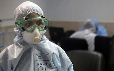 A nurse wears protective gear in a ward dedicated for people infected with the new coronavirus, at a hospital in Tehran, Iran, March 8, 2020. (Mohammad Ghadamali/AP)