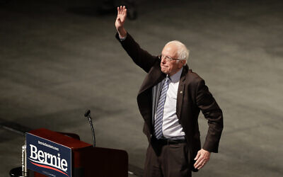 Democratic presidential candidate Sen. Bernie Sanders, waves to supporters during a campaign rally March 9, 2020, in St. Louis. (AP Photo/Jeff Roberson)