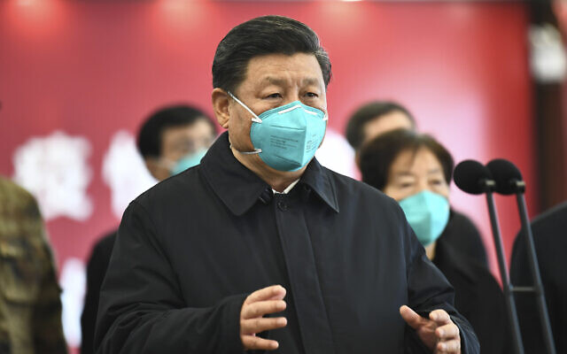 In this photo released by China's Xinhua News Agency, Chinese President Xi Jinping talks by video with patients and medical workers at the Huoshenshan Hospital in Wuhan in central China's Hubei Province, Tuesday, March 10, 2020. (Xie Huanchi/Xinhua via AP)