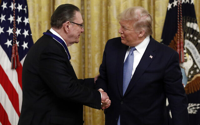 President Donald Trump shakes hands after presenting the Presidential Medal of Freedom to former Vice Chief of Staff of the Army Gen. Jack Keane in the East Room of the White House in Washington, Tuesday, March 10, 2020. (AP/Patrick Semansky)
