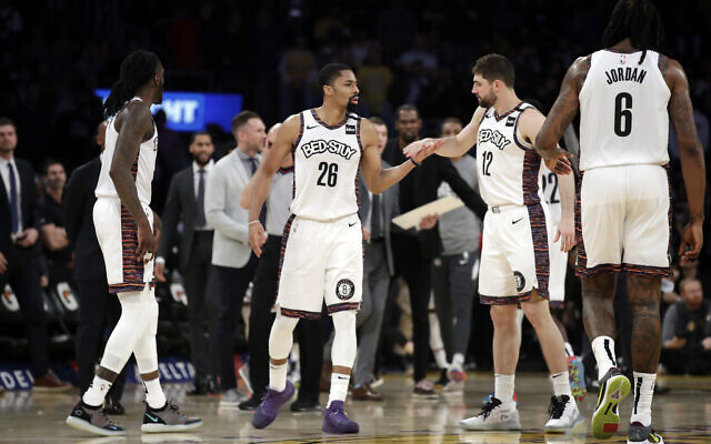 Brooklyn Nets players during the second half of an NBA basketball game against the Los Angeles Lakers Tuesday, March 10, 2020, in Los Angeles. (AP/Marcio Jose Sanchez)