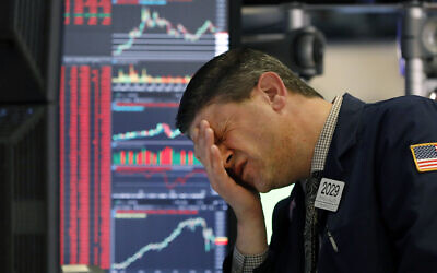 A trader works at his post on the floor of the New York Stock Exchange, March 11, 2020. (AP Photo/Richard Drew)
