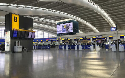 A view of the near empty departure area at London's Heathrow Airport's Terminal 5 departure, March 12, 2020 (Steve Parsons/PA via AP)
