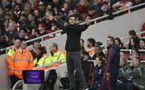 In this Saturday, March 7, 2020 photo Arsenal's head coach Mikel Arteta reacts during the Premier League soccer match between Arsenal and West Ham at the Emirates Stadium in London. (AP/Matt Dunham)