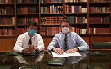 In this handout photo released by Brazil's Presidential Press Office, Brazilian Health Minister Luiz Henrique Mandetta, left, and President Jair Bolsonaro, wear masks as they speak about the new coronavirus during a Facebook Live transmission, in Brasilia, Brazil, Thursday, March 12, 2020.(Brazil's Presidential Press Office via AP)