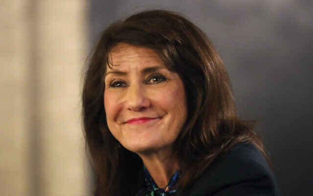 Democrat Marie Newman smiles as she campaigns in the Archer Heights neighborhood of Chicago on March 9, 2020. (AP Photo/Charles Rex Arbogast)