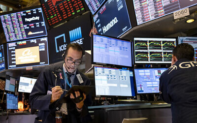 Trader Gregory Rowe works on the floor of the New York Stock Exchange at the end of the trading day Monday, March 16, 2020. (AP/Craig Ruttle)