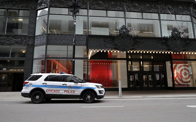 A police car parked in front of a Target store in downtown Chicago, March 22, 2020. (Nam Y. Huh/AP)