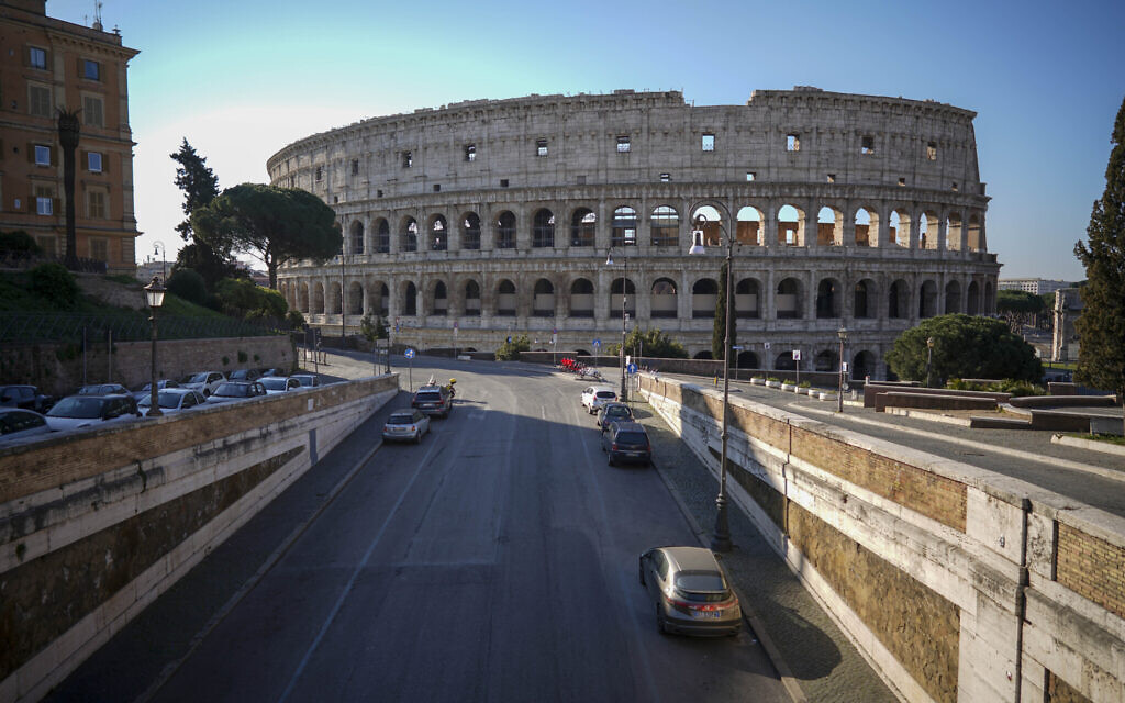 An empty street leads to the ancient Colosseum, in Rome, Tuesday, March 24, 2020. (AP Photo/Andrew Medichini)