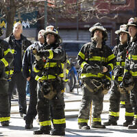Illustrative: Firefighters watch as colleagues work on a minor fire in an elevated subway station, Tuesday, March 24, 2020 in New York. Mayor Bill de Blasio says police will be step in to enforce social distancing. (AP Photo/Mark Lennihan)