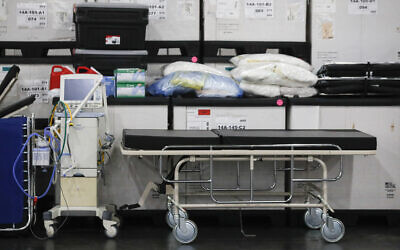 This March 23, 2020, file photo shows medical supplies and a stretcher displayed before a news conference at the Jacob Javits Center in New York. Health care workers are dreading the prospect of deciding which patients would get a ventilator that could save their lives. (John Minchillo, Fle/AP)