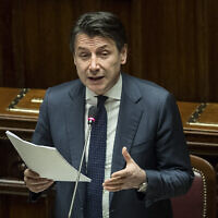 Prime Minister Giuseppe Conte updates the Parliament on the coronavirus emergency in Rome, March 25, 2020. (Roberto Monaldo/LaPresse via AP)